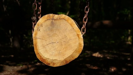 Wood on a chain.