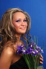 Beautiful girl smelling roses.