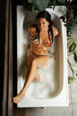Young woman in a bath-tub