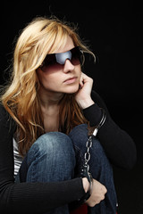 Blonde fashionable girl with handcuffs