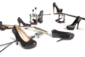 Female shoe and musical instruments scattered