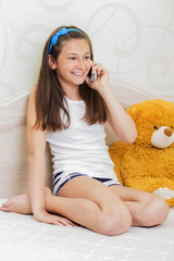 10-13 years girl talking on the phone