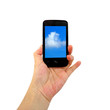 Mobile phone in the hand with blue sky isolated on white