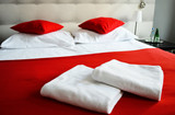 Double bed in hotel room. Accommodation poster