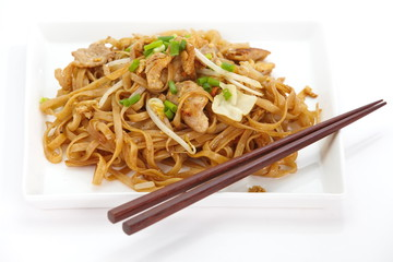 asian food fried rice noodles with pork and vegetables