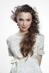 Pretty russian woman with curly hair on white background