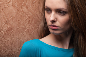 young woman leaning against wall.