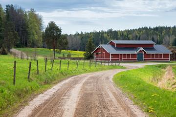 Red barn in scenic rural landscape