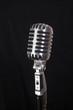 vintage microphone over black background