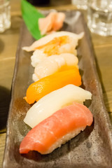 Salmon and Several kinds of raw fish meat in various size and te