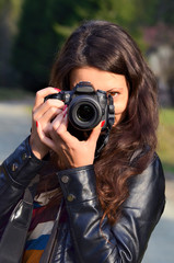 Young woman with DSLR camera