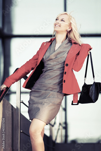 Young fashion business woman against office windows