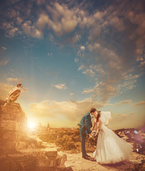 wedding sunset kiss at vintage castle ruins