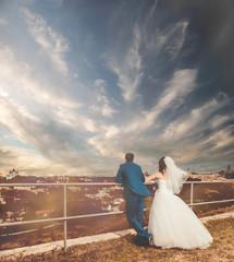 wedding couple sharing sunset