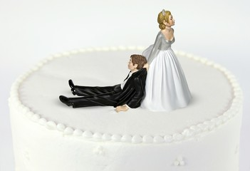 bride and groom on wedding cake tier