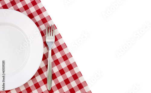 Empty plate on tablecloth - 65039281