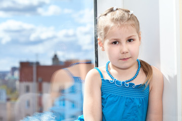 Young Caucasian girl portrait with window, copyspace