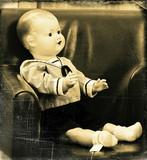 Nostalgia - old puppet on a vintage photo poster