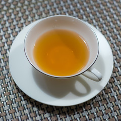 Cup of black tea on the table ready to drink.