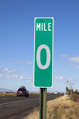 A Green Zero Mile Road Sign on the Freeway