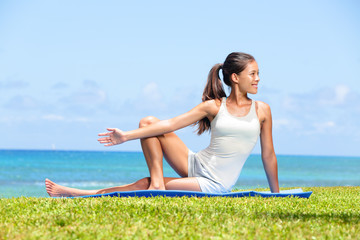 Woman stretching legs in yoga exercise fitness