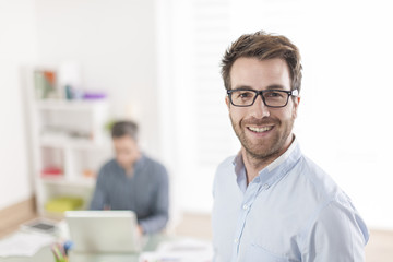 businessman standing in front of his colleagues in office