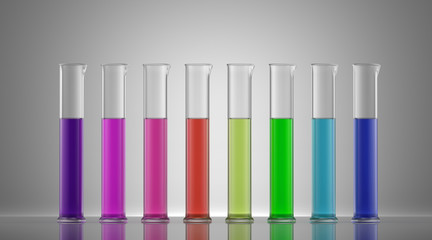 Chemistry laboratory glassware with colour liquids in them.