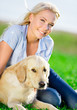 Close up of blond woman with golden retriever
