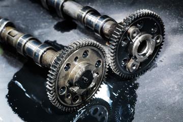 cam shaft of a turbo diesel engine on a dark background
