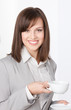 Portrait of businesswoman with white cup