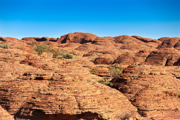 Rough orange mountains in Australian outback in bright sunshine