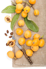 Loquat fruit cut and whole
