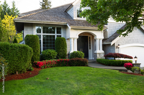 Clean exterior home during late spring season - 65049874
