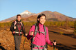 People hiking - healthy active lifestyle couple