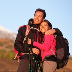 Romantic couple embracing hiking active lifestyle