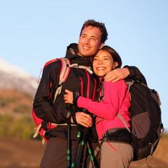 Romantic couple embracing hiking active lifestyle