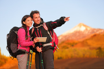 Tablet PC - hiking couple using travel app