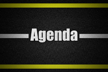 Traffic  road surface with text Agenda