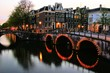 Famous canals of Amsterdam lit up at dusk, Netherlands