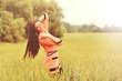 Happy girl in a spring field