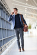 Urban business man talking on smart phone