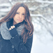Winter fashion outdoor portrait of young attractive brunette
