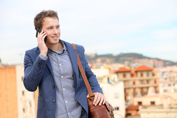 Man on smartphone - young business man talking