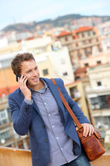 Man on smart phone - young business man talking