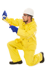 man with screwdriver protective suit