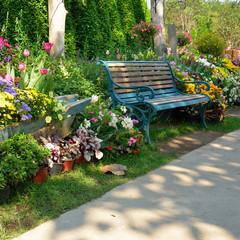 vintage bench in flowers spring summer garden