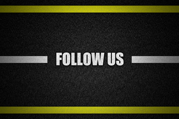 Traffic  road surface with text FOLLOW US