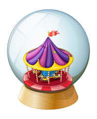 A crystal ball with a kiddie ride inside