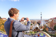 Tourist man taking photo in Park Guell, Barcelona