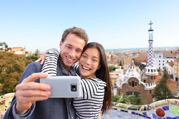 Travel couple happy selfie, Park Guell, Barcelona